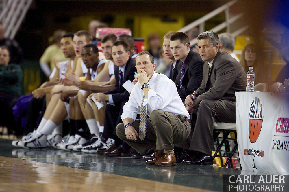 November 27th, 2010:  Anchorage, Alaska - Weber State head coach Randy Rahe squats in front of his bench during the Wildcat's 82-81 come from behind victory over Drake in the third place game of the Great Alaska Shootout.