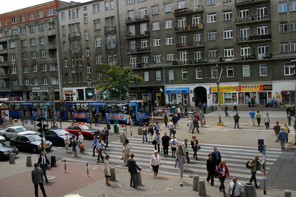 Street scene with electric trolley in Warsaw, Poland.