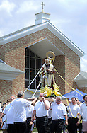 Parishioners carry a sculpture of Padre Pio during a profession though the neighborhood during the first annual Padre Pio Festival at St. Bede the Venerable Church Sunday June 26, 2016 in Northampton, Pennsylvania. (Photo by William Thomas Cain)