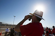 A man looks out across the U.S.-Mexico border from El Paso, Texas, Feb. 17, as Pope Francis celebrates the final Mass of his Mexico visit on the other side in Ciudad Juarez. About 550 guests situated on a levee north of the Rio Grande took part in the service. (CNS photo/Nancy Wiechec)