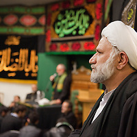 LONDON, ENGLAND - DECEMBER 27:  A Shia Muslim cleric obeserves the congragation inside Holland Park Mosque after the Ashura Procession on December 27, 2009 in London, England. Ashura is a 10 day period of mourning for Imam Hussein, the seven-century grandson of Prophet Mohammad who was killed in a battle in Karbala in Iraq, in 680 AD.  (Photo by Marco Secchi/Getty Images)