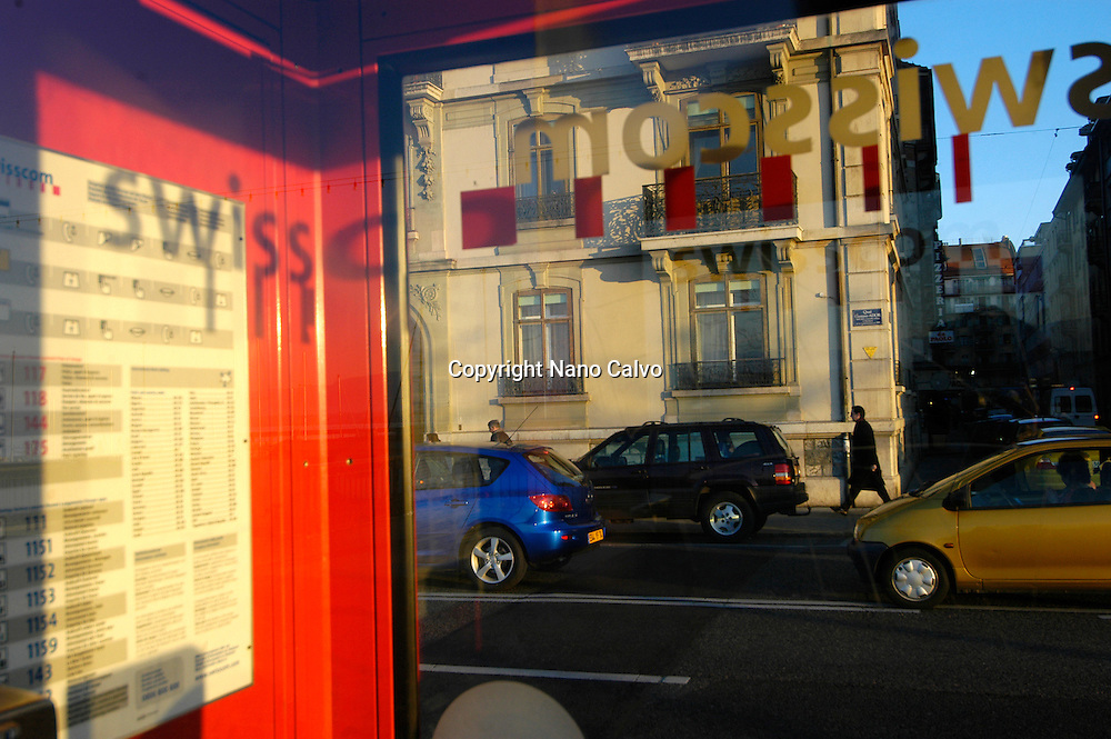 View of the street from inside a Swisscom phone booth, in Geneva, Switzerland