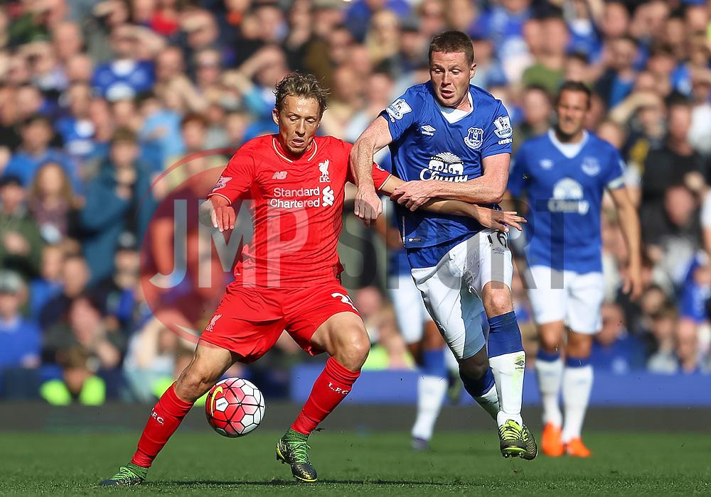 Lucas Leiva of Liverpool and Everton's James McCarthy    - Mandatory byline: Matt McNulty/JMP - 07966 386802 - 04/10/2015 - FOOTBALL - Goodison Park - Liverpool, England - Everton  v Liverpool - Barclays Premier League