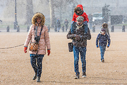 © Licensed to London News Pictures. 26/02/2018. London, UK. A family brave the snow on Horse Guards Parade in Central London. Severe cold, blizzards and heavy snow are expected as the 'Beast from the East' brings freezing Siberian air to the UK. Photo credit: Rob Pinney/LNP