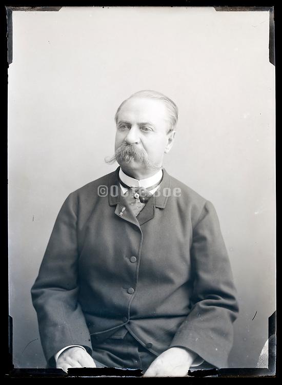 studio portrait of man with big mustache France circa 1920s