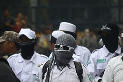 May 9, 2017 - South Jakarta, Capital Region of Jakarta, Indonesia - Thousands of Muslims gathered in front of the Agriculture Ministry office, South Jakarta, where the hearing of a verdict on the blasphemy of Islam with the defendant Jakarta governor Basuki Tjahaja Purnama was held. In the trial, the judge ruled that Basuki, or Ahok, was found guilty of defaming Islam by calling al-Maidah verse 51 of the Koran used by the political elite to fool the public in electoral battles. For that Judge sentenced Ahok with 2 years imprisonment. The crowd cheered expressing his joy over the judge's decision. (Credit Image: © Tubagus Aditya Irawan/Pacific Press via ZUMA Wire)