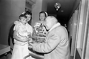 15/02/1963<br /> 02/15/1963<br /> 15 February 1963<br /> Opening of new 5 Star Supermarket in Crumlin, Dublin. Picture shows: Jimmy O'Dea presenting a hamper on behalf of the supermarket to Trevor Jennings, who accepted it for the young patients at Our Lady's Children's Hospital, Crumlin. Included is Nurse Breda Slattery and Sister Aureen O'Neill.