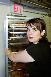 2nd Sept, 2005. New Orleans, Louisiana.<br /> British tourist Kristie Watson finds herself trapped at the Hyatt in New Orleans. Kirstie volunteered to help out and was detailed with assisting in serving breakfast.<br /> Photo Credit; Charlie Varley/varleypix.com