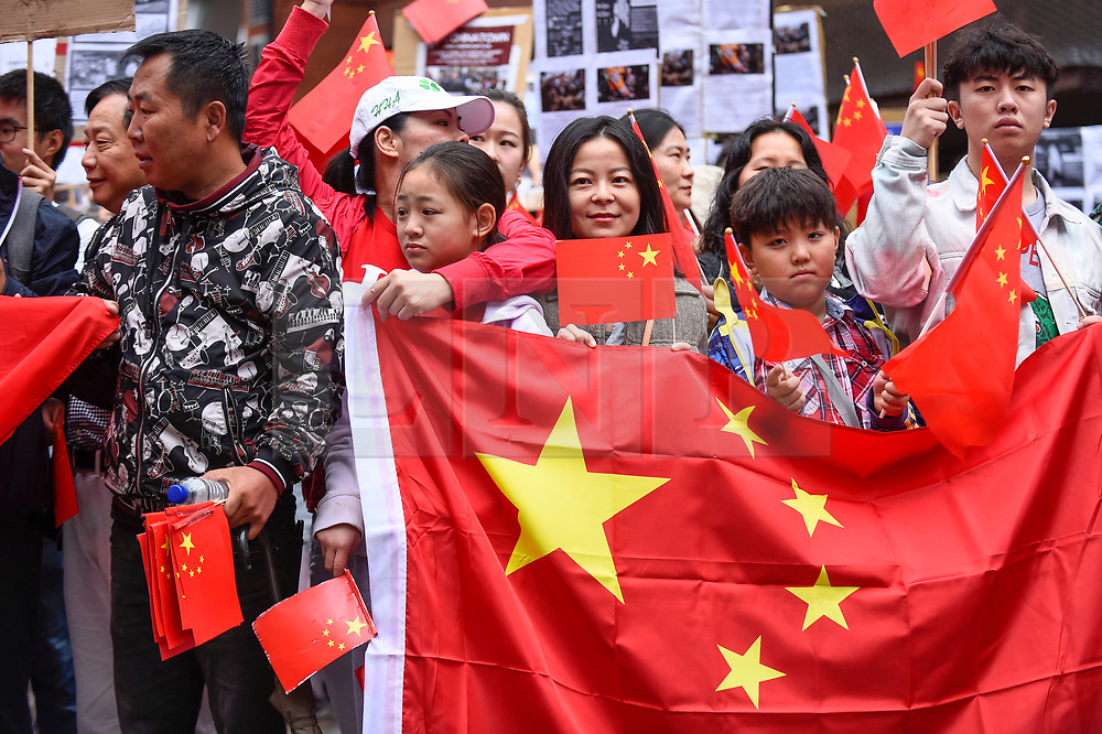 © Licensed to London News Pictures. 18/08/2019. LONDON, UK.  Members of the capital's Chinese community hold a rally in Chinatown to support the people of Hong Kong and China.  They are calling for an end to police violence and a respect for law as protests in the former British colony enter their eleventh week.  Photo credit: Stephen Chung/LNP