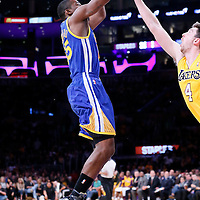 11 April 2014: Golden State Warriors guard Jordan Crawford (55) takes a jumpshot over Los Angeles Lakers forward Ryan Kelly (4) during the Golden State Warriors 112-95 victory over the Los Angeles Lakers at the Staples Center, Los Angeles, California, USA.