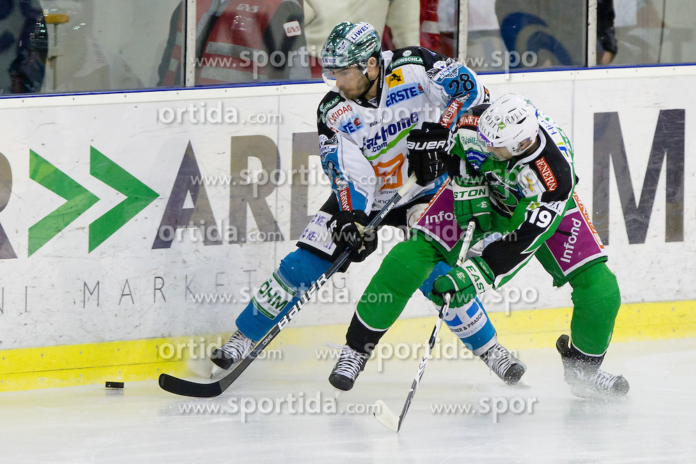 Mike Ouelette (EHC Liwest Linz, #28) vs Ziga Pance (HDD Tilia Olimpija, #19) during ice-hockey match between HDD Tilia Olimpija and EHC Liwest Black Wings Linz at fourth match in Semifinal  of EBEL league, on March 13, 2012 at Hala Tivoli, Ljubljana, Slovenia. (Photo By Matic Klansek Velej / Sportida)