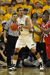 Jan 23, 2010; Columbia, MO, USA; Missouri Tigers forward Justin Safford (23) looks to pass as Nebraska Cornhuskers guard Lance Jeter (34)  in the first half at Mizzou Arena in Columbia, MO. Missouri won 70-53. Mandatory Credit: Denny Medley-US PRESSWIRE