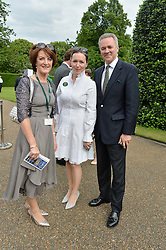 Left to right, EIMEAR MULHERN chairman of Goffs,  REBECCA BURDESS of Fortnum & Mason HENRY BEEBY Chief Execurtive of Goffs at Goffs London Sale held at The Orangery, Kensington Palace, London on 15th June 2015.
