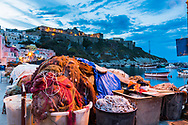 The Citadel watches over the fishing village of Procida Italy