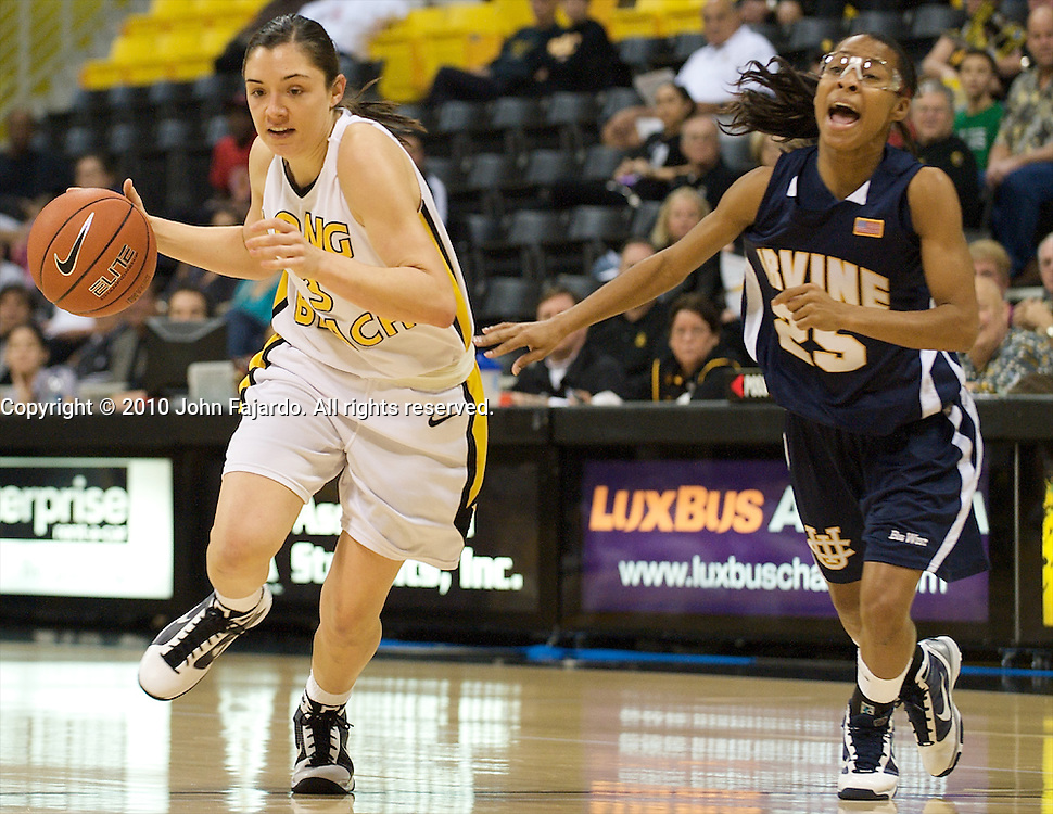 Lauren Sims(L) drives past Keyonna Johnson(25) in the Big West Conference game against U.C. Irvine at the Walter Pyramid, Long Beach Calif, Saturday Jan. 9, 2010.