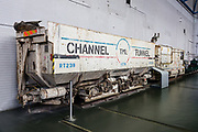 Electric locomotive and muck truck used to build the Channel Tunnel. The spoil deposited at Shakespeare Cliff near Dover increased the size of the UK by 90 acres. Opened in 1994, the Channel Tunnel runs 31.4 miles beneath the English Channel connecting the UK to France. The popular National Railway Museum (NRM) tells the story of rail transport in Britain and houses historically significant artifacts, rolling stock, and over 100 locomotives. Visit it in York, North Yorkshire, England, United Kingdom, Europe. In the 1800s, York became a hub of the British railway network.