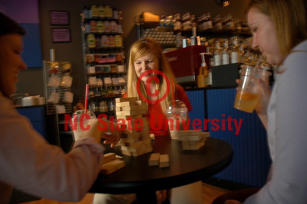 CHASS' Amanda Boykin plays Jenga with friends in an off campus coffe house.   PHOTO BY ROGER WINSTEAD