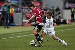 20.02.2010, EasyCredit Stadion, Nürnberg, GER, 1. FBL, 1. FC Nuernberg vs FC Bayern Muenchen, Saison 09 10, im Bild Zweikampf zwischenPhilipp Lahm (Bayern #21) und Christian Eigler (FCN #8). EXPA Pictures © 2010 for Austria, Italy and GBR only, Photographer EXPA / NPH  / Becher / for Slovenia SPORTIDA PHOTO AGENCY.