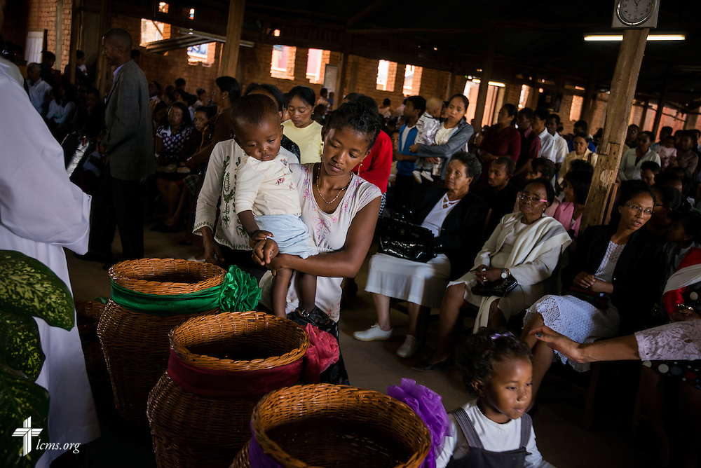 Families give during offertory at Ivato Lutheran Church in the capital city of Antananarivo in Madagascar, on Sunday, Feb. 9, 2014. LCMS Communications/Erik M. Lunsford