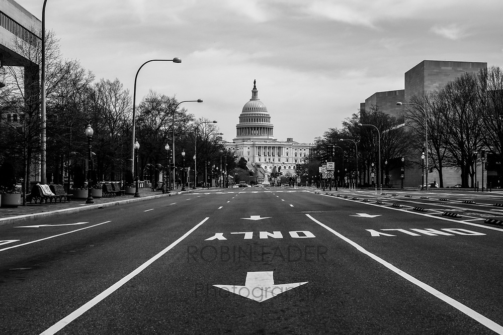 The streets in Washington DC are haunting and empty during the pandemic shutdown.  I stood alone on this normally bustling Pennsylvania Avenue looking at the nation's Capitol Building.