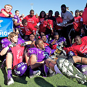 ACU defensive back Kameron Riley clutches the Lonestar Conference trophy as he falls back to pose for a picture with his teammates Satruday afternoon after a 47-17 victory over Southwester Oklahoms State at Shotwell Stadium..photo by Gary Rhodes