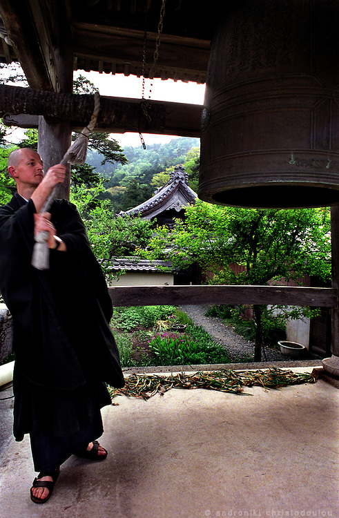 LIVING ZEN - HOSHINJI MONASTERY, OBAMA-JAPAN..Soojii ringing the bell that calls everyone to have lunch.