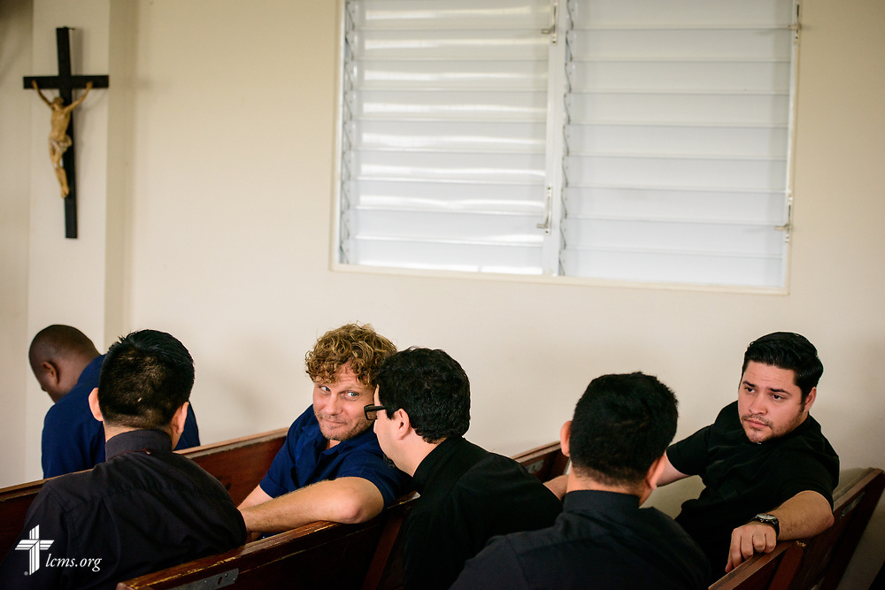 The Rev. David Preus, LCMS career missionary to the Dominican Republic, talks with Marcelo Rivas, a seminarian from Chile, as he and fellow students wait for the start of chapel at the Concordia Reformer Lutheran Seminary and Mercy Center in Palmar Arriba, Dominican Republic, on Wednesday, Oct. 18, 2017. LCMS Communications/Erik M. Lunsford