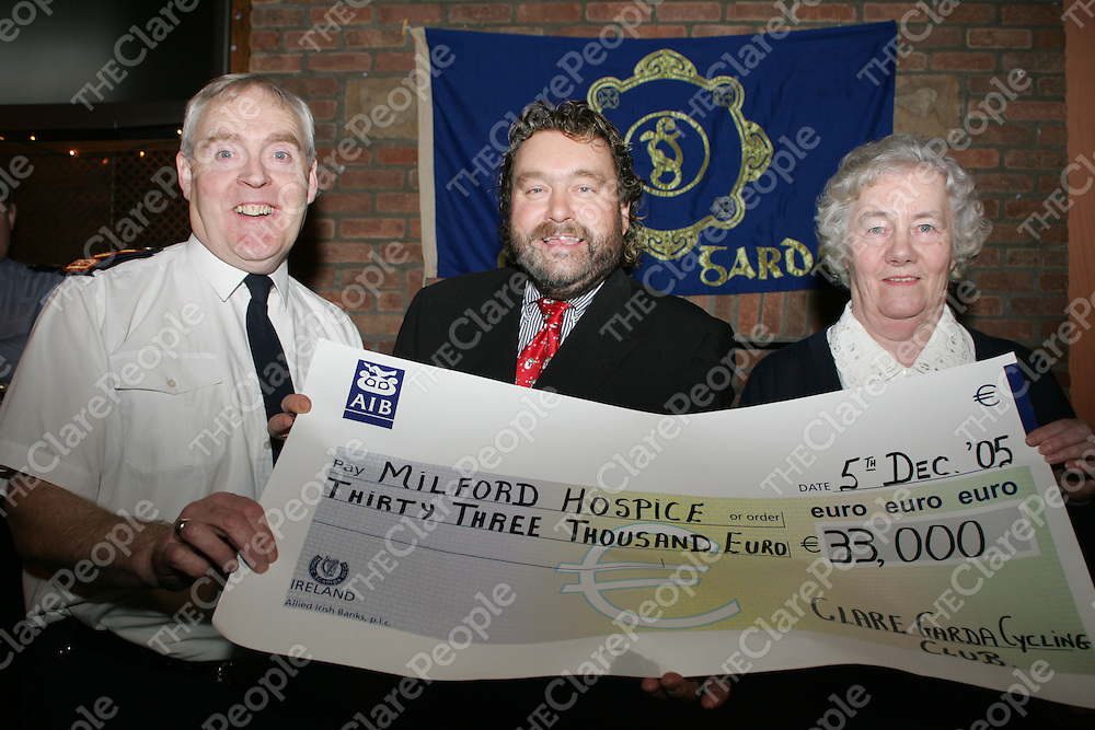 Chief Super - Liam Quinn, Brendan Grace and Sr. Phillis Donellan-Milford Hospice, pictured at the cheque presentation of EUR33,000 from the Garda cycle club to Milford Hospice in Brendan Grace Bar in Kilalloe on Monday night. Pic. Brian Arthur/ Press 22.