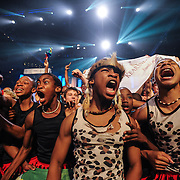 Members of the Kearsney College Choir, South Africa conducted by Bernard Krüger celebrate their victory in the Scenic Folklore category during the final of four Award Ceremonies at the World Choir Games, July 14, 2012. (Photo: Sean Hughes)