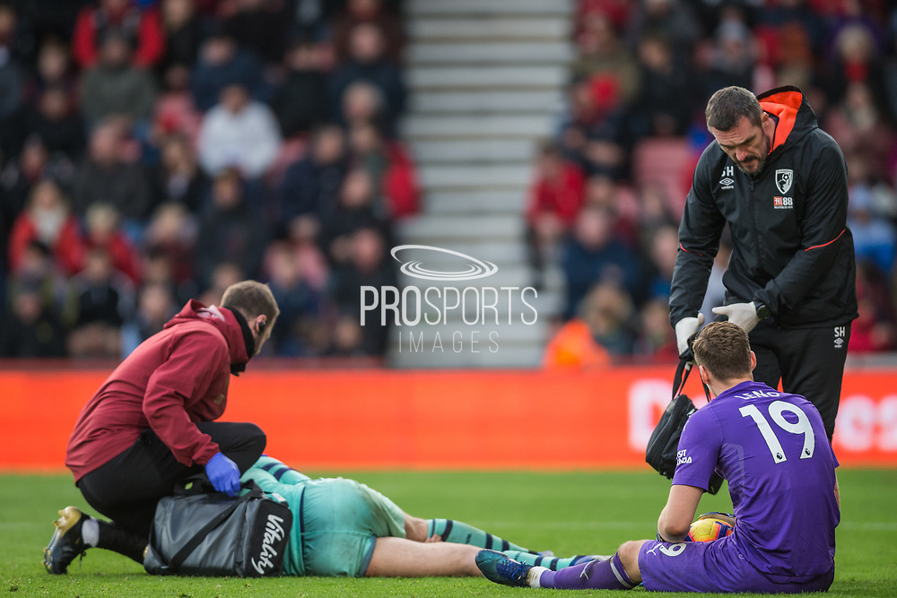 Shkodran Mustafi (Arsenal) receiving treatment and Bernd Leno (GK) (Arsenal) during the Premier League match between Bournemouth and Arsenal at the Vitality Stadium, Bournemouth, England on 25 November 2018.