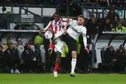 Derby County defender Richard Keogh (6) and Stoke City forward Mame Biram Diouf (18) during the EFL Sky Bet Championship match between Derby County and Stoke City at the Pride Park, Derby, England on 13 March 2019.