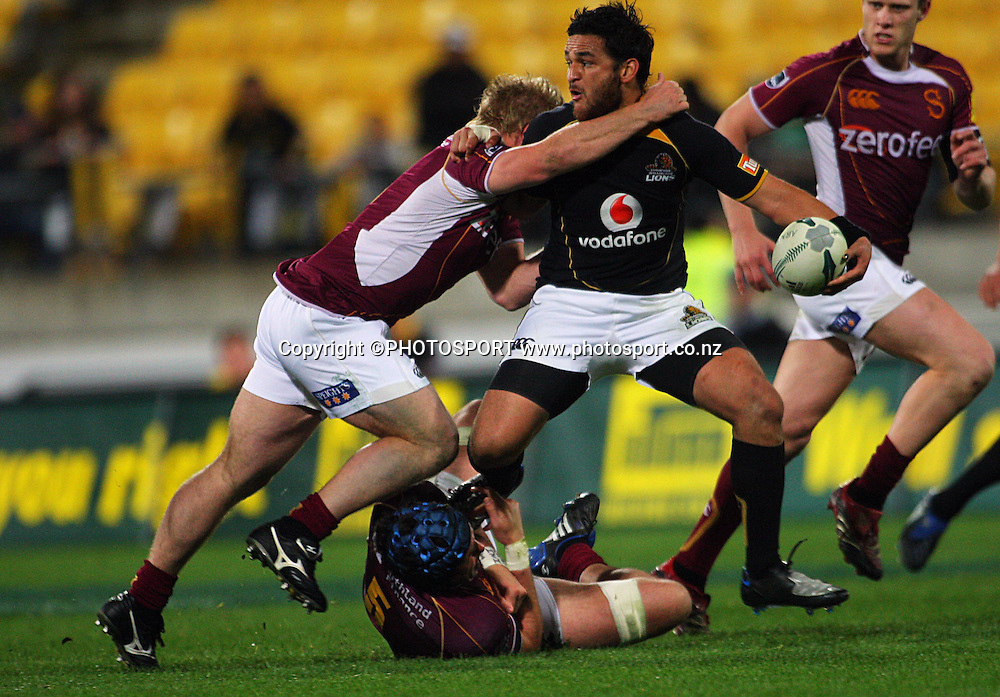 Piri Weepu tries to get a pass away in Matt Holloway's tackle.<br /> Air NZ Cup semi-final. Wellington Lions v Southland Stags at Westpac Stadium, Wellington, New Zealand, Friday, 17 October 2008. Photo: Dave Lintott/PHOTOSPORT