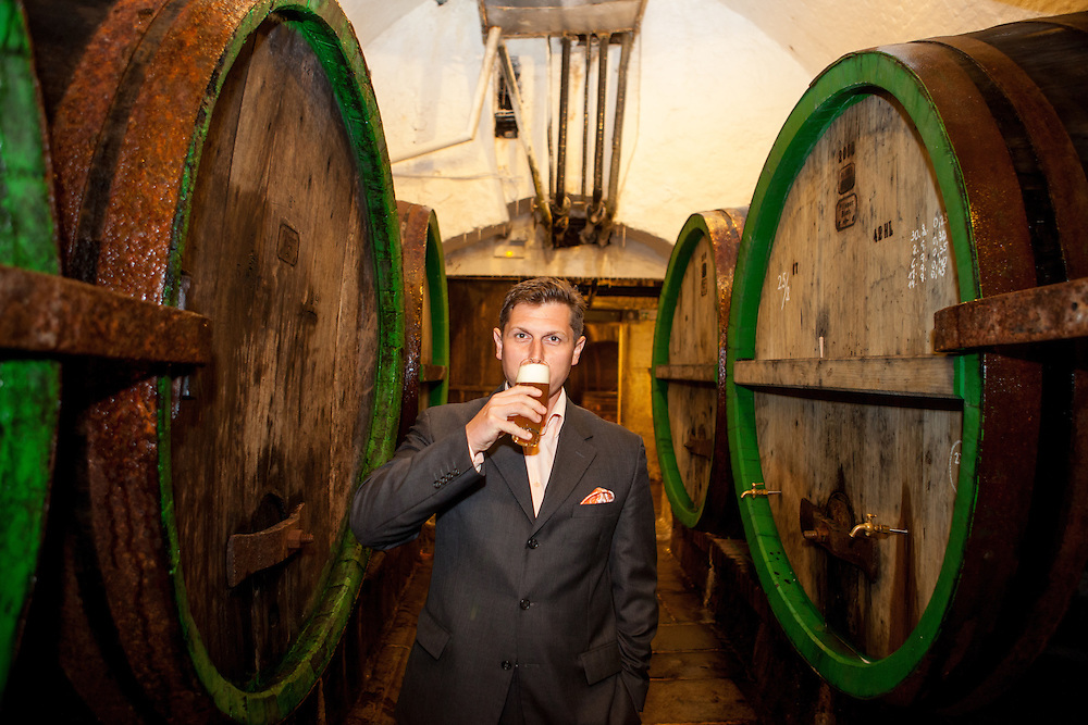 Rudolf Slehofer (38)  - Tourism and Heritage Manager of the Pilsner Urquell brewery with a fresh draught beer in the cellars under the brewery in Pilsen.