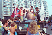 Ravers cheering from their truck at the 2nd Criminal Justice March, Victoria, London, UK, 23rd of July 1994.