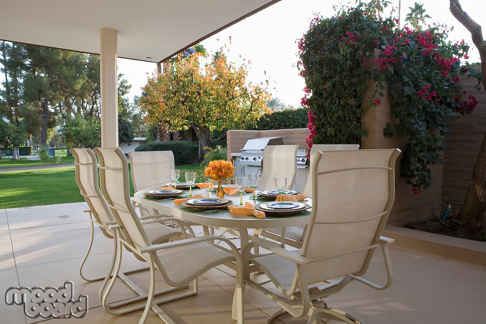Table set for meal on patio