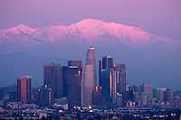 L.A. Skyline with Sunset Alpenglow on Snowy Mount Baldy Peak in Background, Southern California<br />