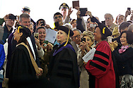 (Wellesley, Ma 052617) People take pictures as Hillary Clinton proceeds into the 139th commencement of Wellesley College. May 26, 2017  Staff photo Chris Christo