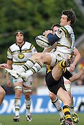 Wycombe, GREAT BRITAIN,  Saints', Ben FODEN, Knocks, Wasps' Mark VAN GISBERGEN as the contest the high ball, during the Guinness Premiership rugby game, London Wasps vs Northampton Saints, at Adam's Park Stadium, Bucks, England, on Sun 22.02.2009. [Photo, Peter Spurrier/Intersport-images]