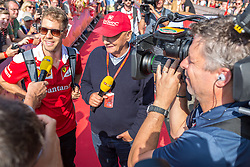 02.07.2016, Red Bull Ring, Spielberg, AUT, FIA, Formel 1, Roter Teppich, im Bild Sebastian Vettel (GER) Scuderia Ferrari, Niki Lauda (AUT) Mercedes AMG Petronas F1 Team // German Formula One driver Sebastian Vettel of Scuderia Ferrari, Mercedes AMG F1 Non-Executive Chairman Niki Lauda (AUT) during the red carpet of at the Red Bull Ring in Spielberg, Austria, 2016/07/02, EXPA Pictures © 2016, PhotoCredit: EXPA/ Dominik Angerer
