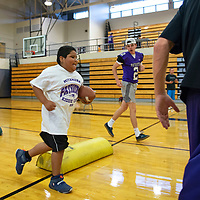 Alexzander Sandoval, 9, participates in a competition agility drill at the Miyamura High School Football Kiddie Camp Thursday, August 1 in Gallup.