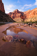Nankoweap Mesa reflects in the waters of a Nankoweap Creek. River mile 53 in Grand Canyon National Park in Arizona.