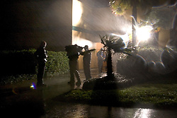 24 Sept, 2005.  Beaumont, Texas. Hurricane Rita <br /> <br /> American TV crew gives a live report from the storm outside the Hotel Elegante in Beaumont as Hurricane Rita roars in in the early hours of Saturday morning.<br /> Photo; ©Charlie Varley/varleypix.com