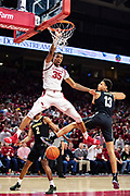 FAYETTEVILLE, AR - FEBRUARY 5:  Reggie Chaney #35 of the Arkansas Razorbacks goes up for a dunk against Matthew Moyer #13 of the Vanderbilt Commodores at Bud Walton Arena on February 5, 2019 in Fayetteville, Arkansas. The Razorbacks defeated the Commodores 69-66.  (Photo by Wesley Hitt/Getty Images) *** Local Caption *** Reggie Chaney; Matthew Moyer