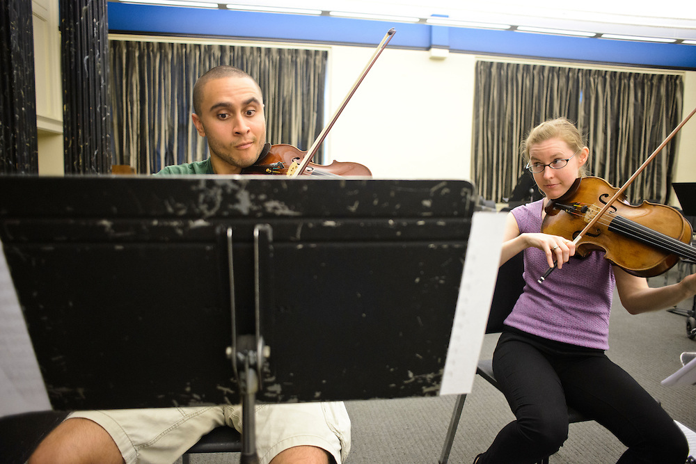 (photo by Matt Roth).Assignment ID: 30127886A..BSO Academy violin student Matt DeBeal, a middle school strings teacher from Laurel, MD, practices next to Karin Brown, acting assistant principal viola player with the Baltimore Symphony Orchestra during their chamber music rehearsal at the Baltimore School for the Arts Tuesday, June 26, 2012. ..