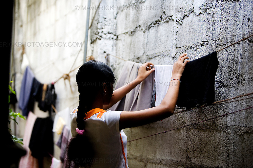 General views of a clothing factory in Colombo, Sri Lanka which manufactures goods for export to western markets. Picture shows a garment worker hanging washed clothes...