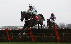 Mr Fisher and Nico de Boinville clear the last flight before going on to win The 32Red Casino NovicesÕ Hurdle Race run during day one of 32Red Winter Festival at Kempton Park Racecourse.