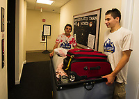 Raymond Townsend and Samuel Avard help incoming students at the Apple Ridge student apartments during Move In day for Lakes Region Community College Sunday morning.  (Karen Bobotas/for the Laconia Daily Sun)