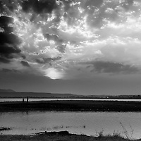 During the suset, the sky was dramatic, the 2 figures in the foreground added the life.