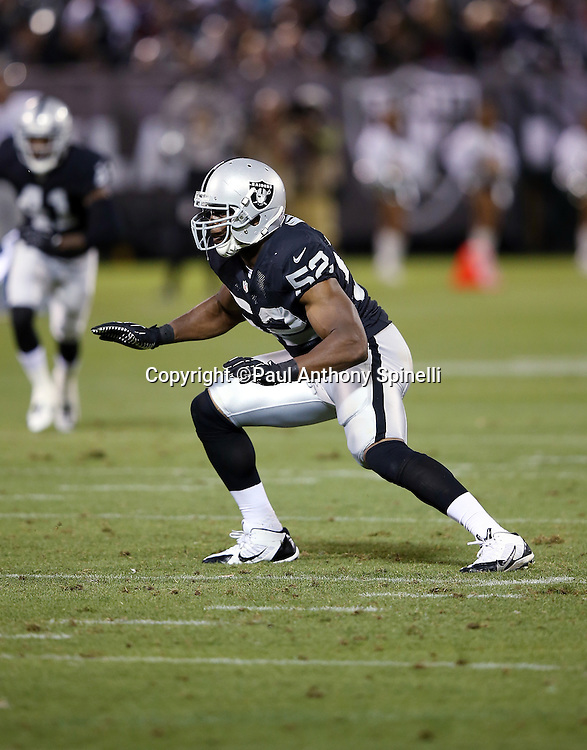 Oakland Raiders outside linebacker Khalil Mack (52) chases the action during the 2014 NFL preseason football game against the Detroit Lions on Friday, Aug. 15, 2014 in Oakland, Calif. The Raiders won the game 27-26. ©Paul Anthony Spinelli