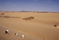 sliding down a dune in the Sahara